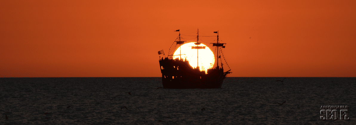 Sailing Into the sinset sm wm Sunset at Clearwater Beach Florida